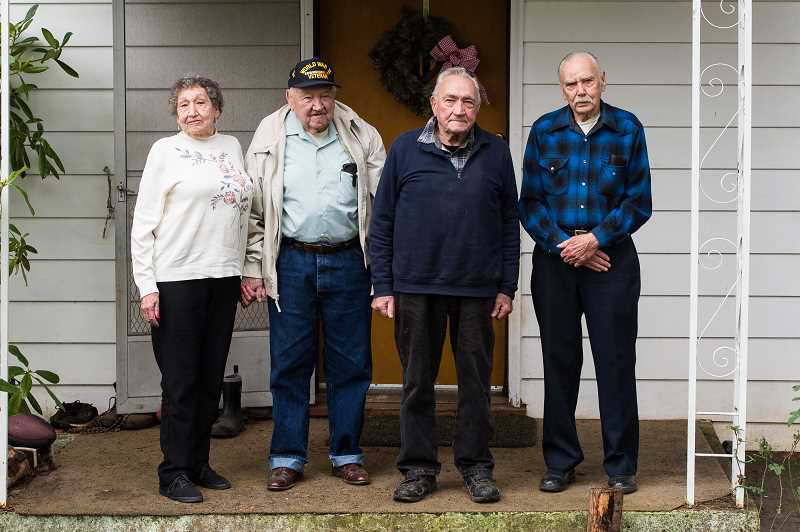 NEWS-TIMES PHOTO: CHRISTOPHER OERTELL - (Left to right) June VanderZanden, and Jack, Burl and Parnell Jarrell stood in front of the childhood home they built in 1940 with their parents outside Forest Grove.