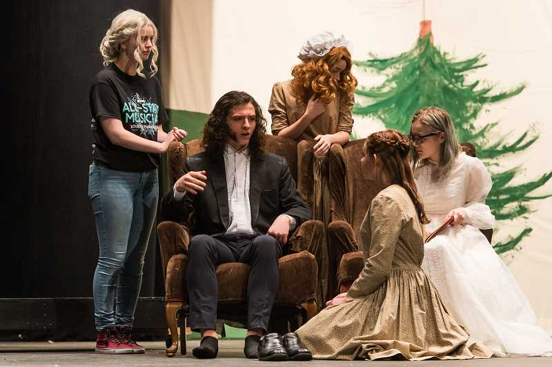 NEWS-TIMES PHOTO: CHRISTOPHER OERTELL - (Left to right) Aubry Crouch, Jordon DiNocenzo, Adrian Evans, Linnaea Rusaw and Katy Schlesser play Mr. Bennet and his daughters, gathering together to hear news of one of their sisters.