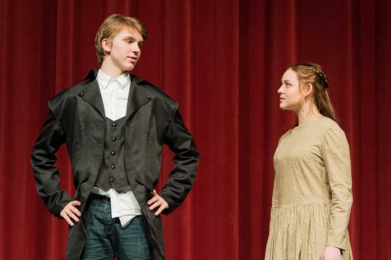 NEWS-TIMES PHOTO: CHRISTOPHER OERTELL - Skylar Brainard and Linnaea Rusaw play Mr. Fitzwilliam and Elizabeth Bennet as they discuss the mysterious Mr. Darcy.