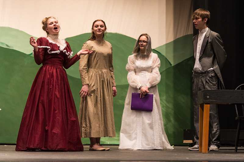 NEWS-TIMES PHOTO: CHRISTOPHER OERTELL - Ruth Halley, Linnaea Rusaw, Katy Schlesser and Gibson Landreville, act out a scene that shows Caroline Bingley surprised to see Elizabeth Bennet with Mr. Darcy and his sister.