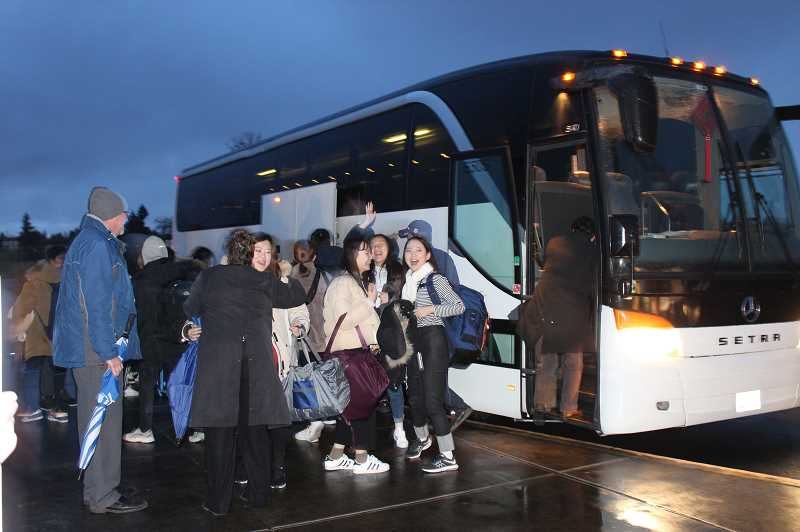 HERALD PHOTO: KRISTEN WOHLERS - The South Korean visitors gather their things before partnering up with their Baker Prairie hosts that they stayed with for the week of Jan. 11-17.
