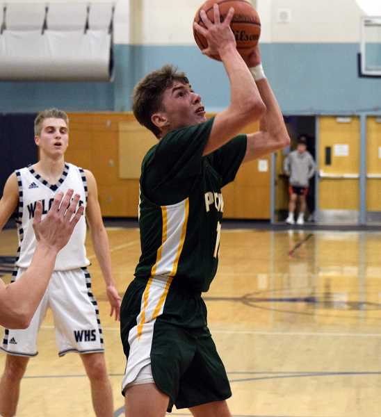 SPOKESMAN PHOTO: TANNER RUSS - Putnam junior Ruben Onishchenko goes to the basket for a layup against Wilsonville. Onishchenko had 11 points against Wilsonville in the Kingsmens 68-47 loss.
