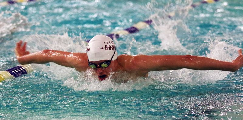 DAN BROOD - Sherwood High School senior Danny Bassich is on his way to picking up a victory in the 100-yard butterfly event during the Bowmen's Three Rivers League meet at Tualatin.