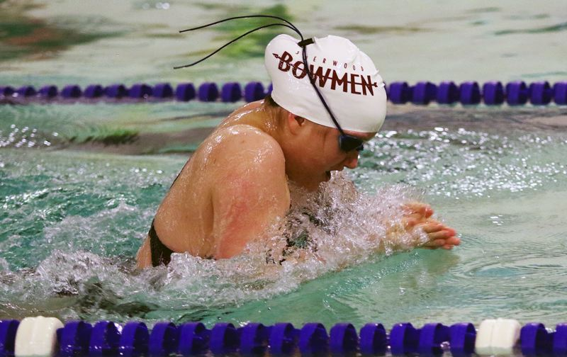 DAN BROOD - Sherwoods Shelby Slens is on her way to victory in the 100-yard breaststroke event.