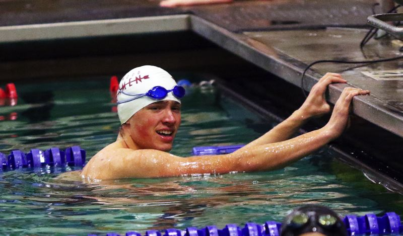 DAN BROOD - Sherwood's Brandon Hughes smiles after swimming to victory in the 50 freestyle event.