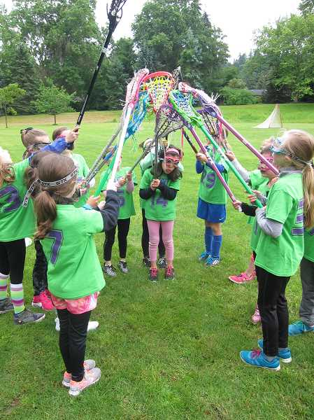 SUBMITTED PHOTO  - Girls in first and second grade can learn the fundamentals of womens lacrosse this spring through Lake Oswego Parks and Rec. Sign up now.