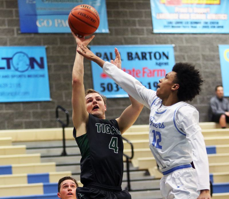 DAN BROOD - Tigard junior Stevie Schlabach (left) shoots over Lakeridge's Tony Fair during Friday's game.
