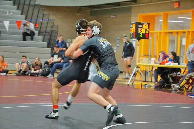 PHOTO CREDIT: AMY GADBOIS - Lions sophomore Ryan Burri battled to fifth at 152.