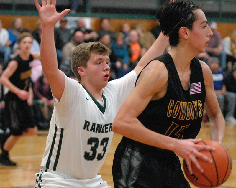 ESTACADA NEWS: MATT RAWLINGS - Estacada's Eli Crombie (left) traps Crook County's Jordan Graydon on the baseline.