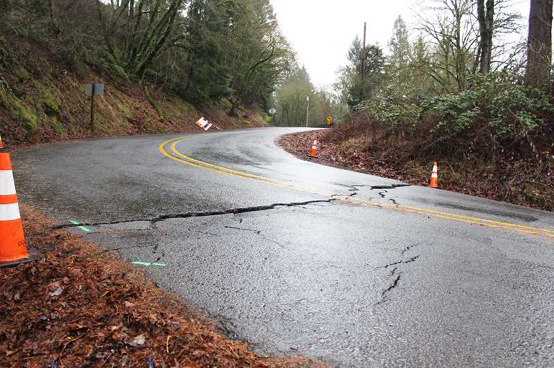 PIONEER PHOTO: KRISTEN WOHLERS - Cracks on Eldorado Road at its southern intersection with Highway 213 have widened, calling for a closure of the intersection on Jan. 18.