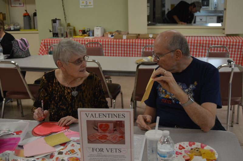 SPOTLIGHT PHOTO: COURTNEY VAUGHN - Barbra and Gilbert Bynoe of St. Helens craft valentine cards together Monday, Jan. 15, during the Valentines for Vets service project at the Scappoose Senior Center. The annual service project is put on by the Columbia County RSVP, gathering senior volunteers to make cards that will be distributed to veterans before Valentines Day.