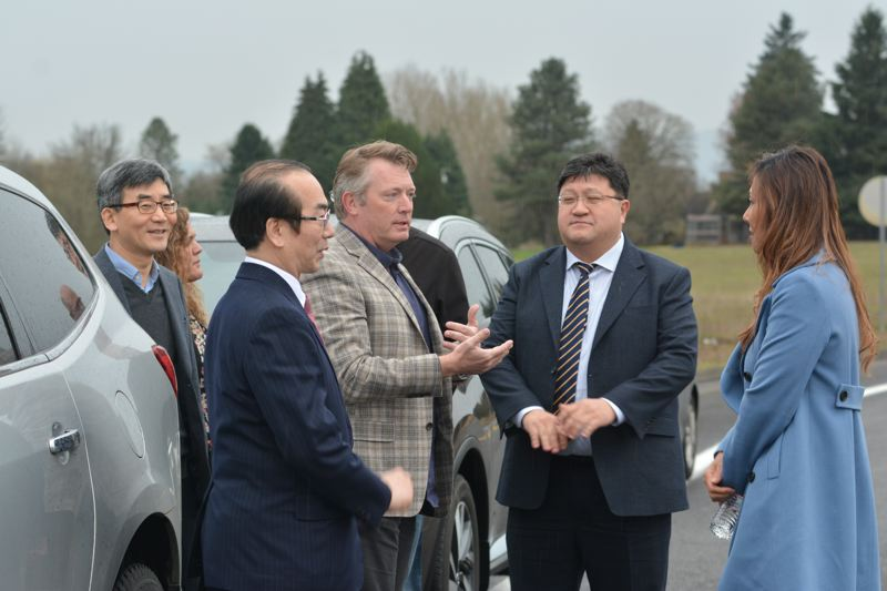 SPOTLIGHT PHOTO: COURTNEY VAUGHN - Port of St. Helens Executive Director Doug Hayes (center) introduces McNulty Creek Industrial Park in St. Helens to entrepreneurs from South Korea.