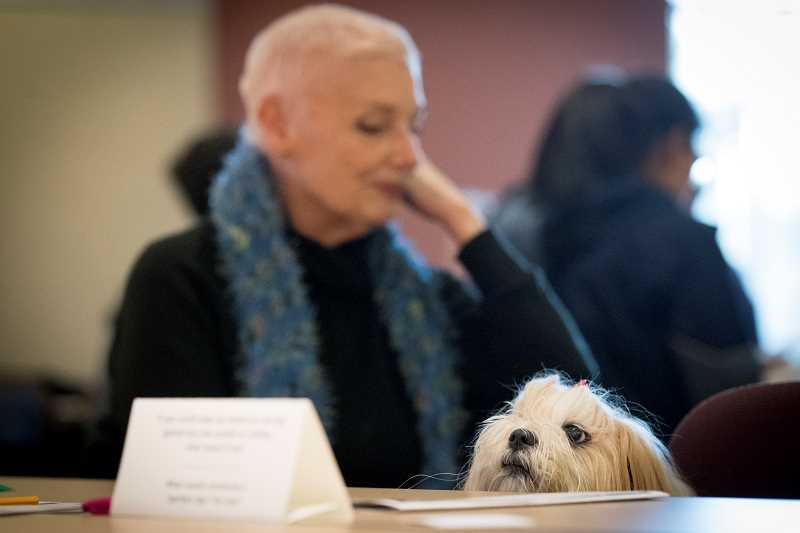 TIMES PHOTO: JAIME VALDEZ - Jeannette, a patron of the Tigard Public Library, attends a MLK Day: Together at the Table event with her dog, Eros,  at the library on Monday.