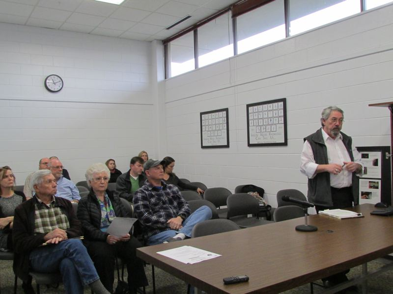SPOTLIGHT PHOTO: COURTNEY VAUGHN - Glen Higgins of Columbia County Land Development Services addresses county commissioners during a public hearing on marijuana land use rules Wednesday, Jan. 17.