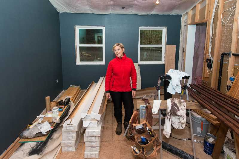 HILLSBORO TRIBUNE PHOTO: CHRISTOPHER OERTELL - Kim Maus stands inside what will be the master bedroom of a remodel she and husband Matt Weishoff are doing on their 600-square-foot home in North Plains.