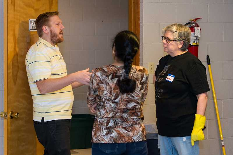 HILLSBORO TRIBUNE PHOTO: CHRISTOPHER OERTELL - Peter Kass, employment coordinator for Home Plate, talks to volunteers during a cleanup event for the HomePlate Youth Servicesorganization at First Congregational Church in Hillsboro on Monday, Jan. 15.