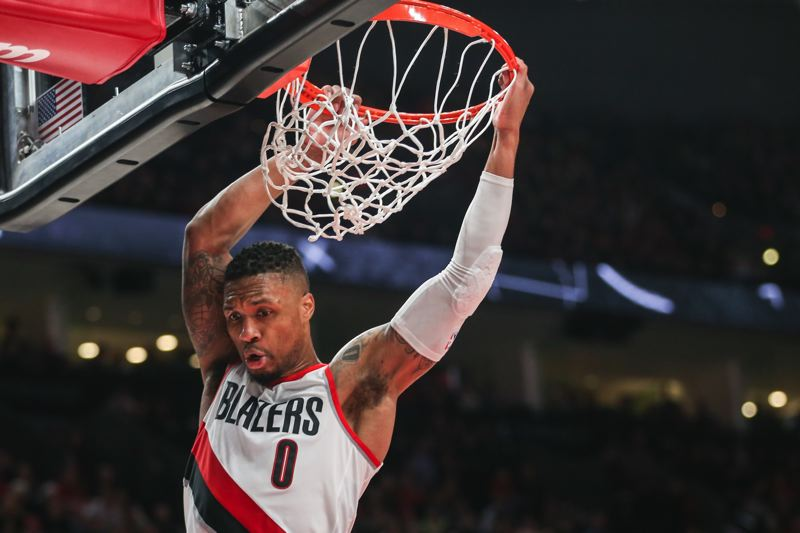 TRIBUNE PHOTO: DAVID BLAIR - Damian Lillard slams in a rebound Thursday as the Trail Blazers defeat the Indiana Pacers.