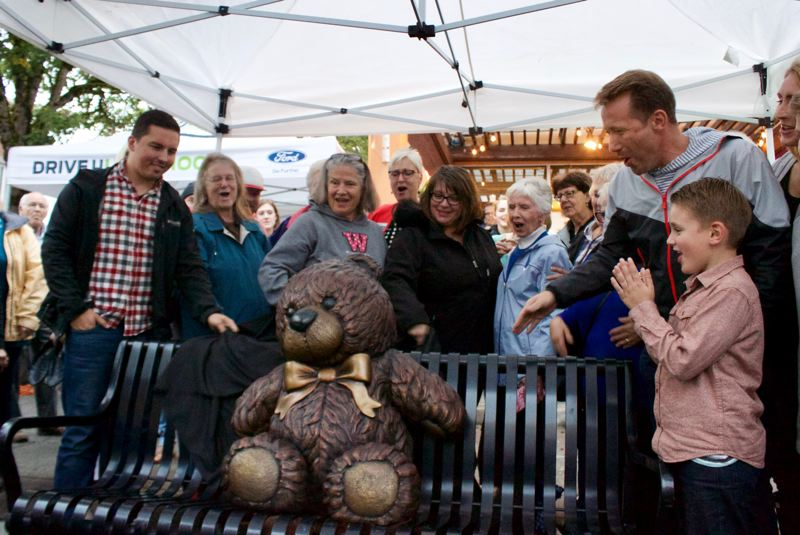 OUTLOOK FILE PHOTO - Gresham Mayor Shane Bemis, right, celebrated the unveiling of the bronze teddy bear, a key part of the ever-popular Teddy Bear Parade.