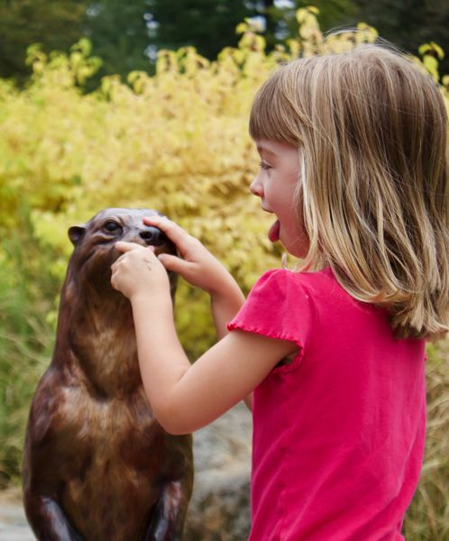 OUTLOOK FILE PHOTO - Children love petting Slider the bronze otter at Nadaka Nature Park. The statue, made by Troutdales Rip Caswell, was put in place through support from the Gresham Outdoor Public Art group.