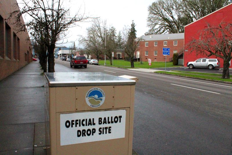 NEWS-TIMES PHOTO: MARK MILLER - You can drive up to this official dropbox on Pacific Avenue in front of the Forest Grove City Library to deposit your ballot and have it count any time before 8 p.m. Tuesday, Jan. 23.