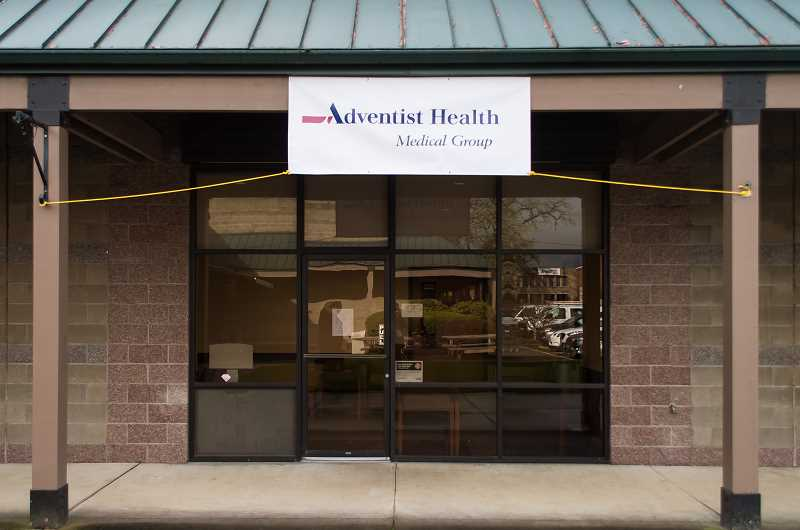NEWS-TIMES PHOTO: CHRISTOPHER OERTELL - A temporary sign hangs outside of the new Adventist Health Clinic in Banks.