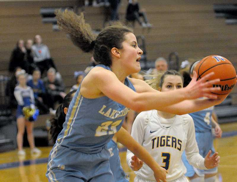 SETH GORDON - Lakeridge junior Brooke Clinton hauls in a rebound during the Pacers' 49-40 road win at Newberg Friday night. Clinton scored a team-high 13 points.
