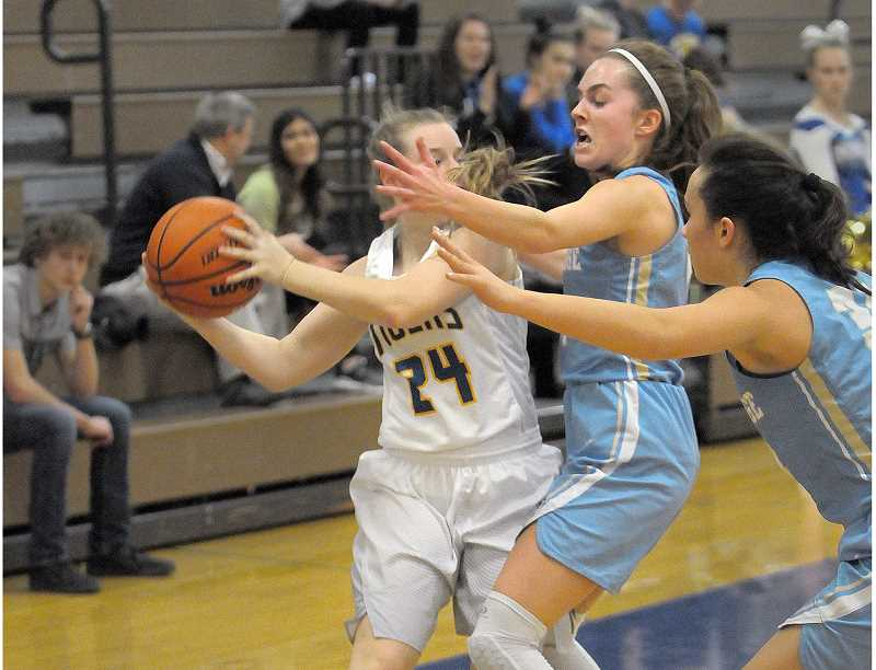 SETH GORDON - Senior guard Laura Barton harasses Newberg's Jessica Bue during Lakeridge's 49-40 road win at Newberg Friday night.