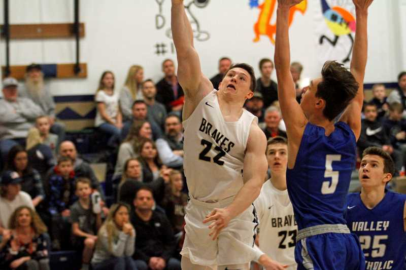 NEWS-TIMES PHOTO: WADE EVANSON - Banks' Trevor Geraci goes up for a lay-in during the Braves' game against Valley Catholic Jan. 19 at Banks High School.