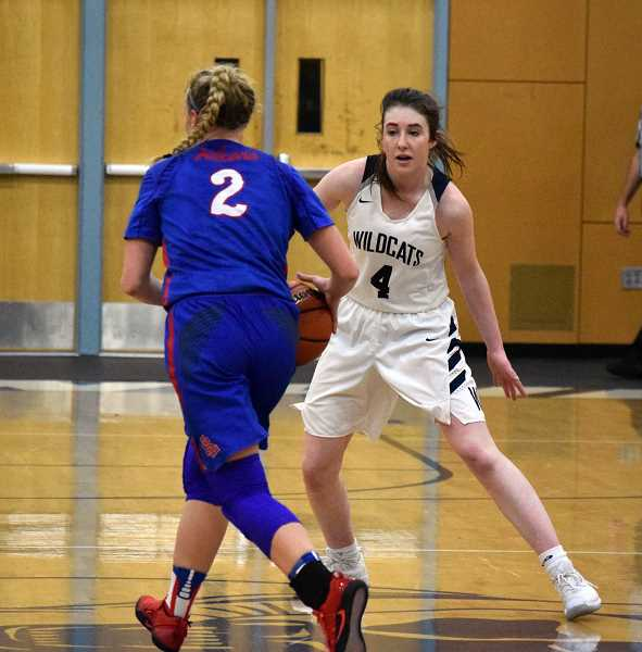 SPOKESMAN PHOTO: TANNER RUSS - Wilsonville junior Teagan McNamee earned praise from her coach after the game for her hustle and adaptability. McNamee had just three points in Wilsonvilles 59-48 loss to La Salle on Friday, Jan. 19.