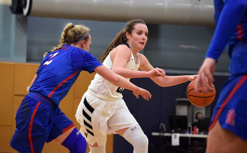 SPOKESMAN PHOTO: TANNER RUSS - Wilsonville junior Cydney Gutridge led her team in scoring with 18 points against the La Salle Falcons. It was not enough though, as La Salle defeated the Wildcats 59-48.
