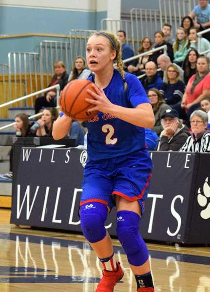 SPOKESMAN PHOTO: TANNER RUSS - La Salles Emily Niebergall led her team in scoring with 18 points against the Wilsonville Wildcats. It was that contribution in the first half that kept La Salle in the game. The Falcons defeated the Wildcats 59-48 on Friday, Jan. 19.