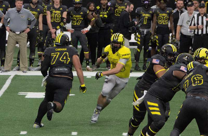 SUBMITTED PHOTO - Draco comes around the end of the line against the best high school football players from the East at the Army All-American Bowl.
