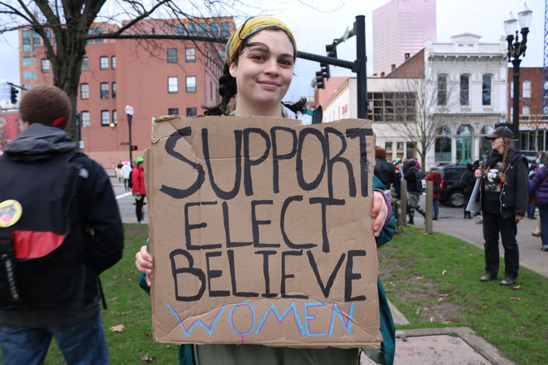 TRIBUNE PHOTO: ZANE SPARLING - Phoebe Clement, a 19-year-old Lewis & Clark College student, carried a sign reading 'Support elect believe women.'