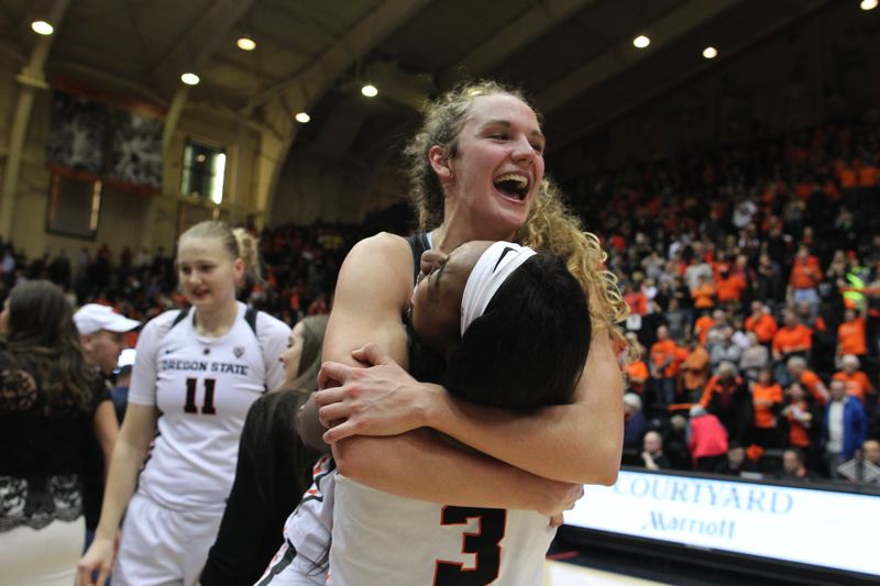TRIBUNE PHOTO: JAIME VALDEZ - Katie McWilliams of the Beavers gets a hug from teammate Madison Washington (3) after the game.