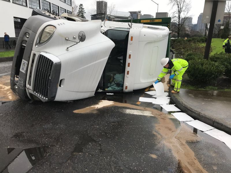 COURTESY ODOT - Hazmat crews responded to the scene of a roll over semi crash at the bottom of the northbound I-5 off-ramp to Water Avenue on Sunday.