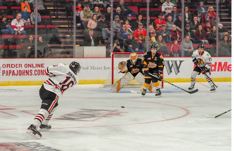 COURTESY: CHAD BAKER/PORTLAND WINTERHAWKS - Portland Winterhawks defenseman Henri Jokiharju shoots against the Brandon Wheat Kings on Sunday at Moda Center.