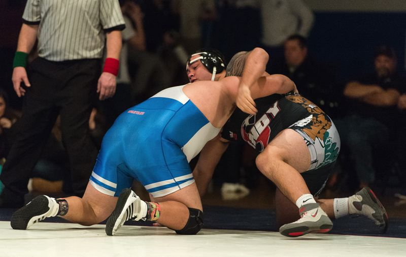 PAMPLIN MEDIA: CHRIS OERTELL - Sandy heavyweight Iosefa Polamalu counters Hillsboros Joshua Villa-Hernandez on his way to a first-period fall in last weeks dual. Polamalu also won the weekends heavyweight title at the Resers Tournament of Champions.