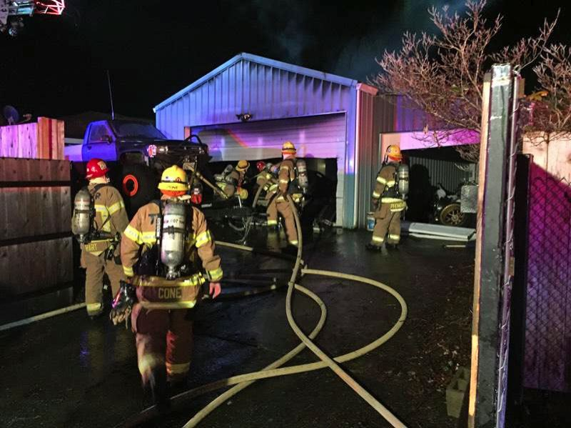 PHOTO COURTESY: TVF&R - Fire crews fight a shop fire early on Monday, Jan. 22.