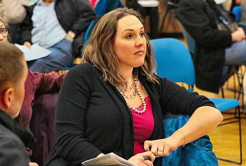 DAVID F. ASHTON - Woodstock Neighborhood Association Chair Elisa Edgington listened intently to budget-cut proposals presented by the Parks Bureau, one of which might close the Woodstock Community Center.