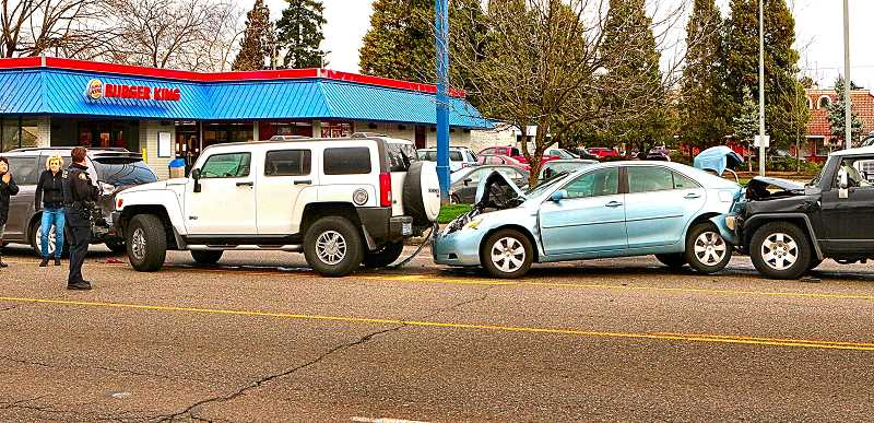 DAVID F. ASHTON - Traffic in front of Eastport Plaza comes to a halt on a busy Saturday afternoon, when four vehicles slam together in a chain-reaction smashup.