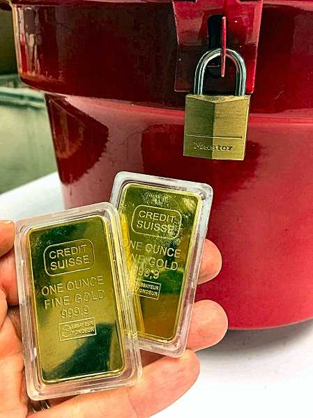 COURTESY OF THE SALVATION ARMY - These two solid gold bars, placed in red kettles at the Foster Road Fred Meyer store, will be used to help people right here in the community, say Salvation Army officials.