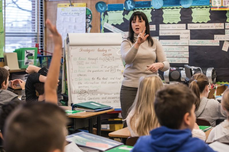 PORTLAND TRIBUNE: JONATHAN HOUSE - Russian Immersion teacher Olessia Bordioug leads her Kelly Elementary class through a Russian lesson.