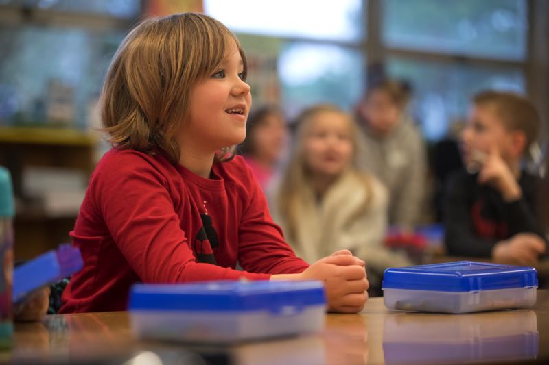 PORTLAND TRIBUNE: JONATHAN HOUSE - Russian Immersion student Rose Plont follows along with spoken English exercises at Kelly Elementary.