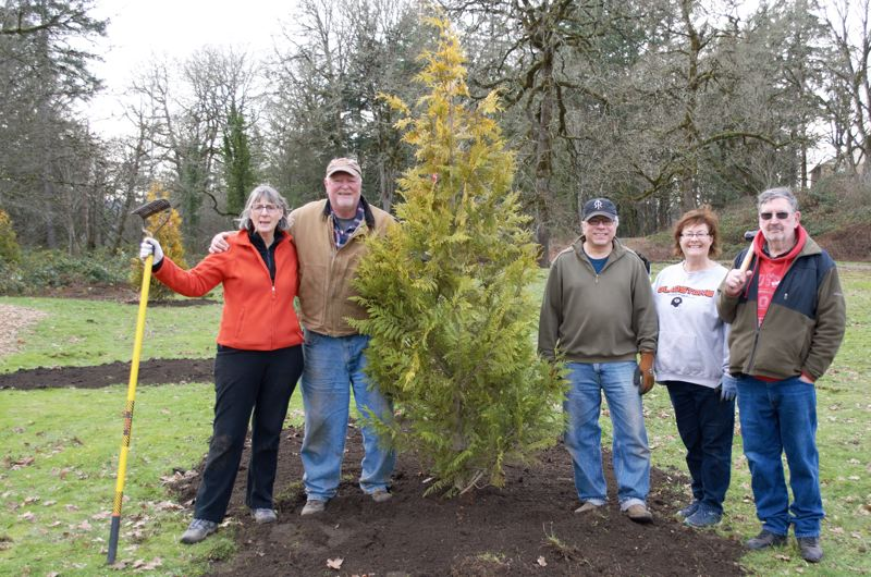 PHOTO BY: WILLIAM PREBLE - Celebrating after planting trees in Gladstone Nature Park are, from left, Nancy Turner, Jim Miller, Lee Toft, Lisa Preble and Gary Bokowski.