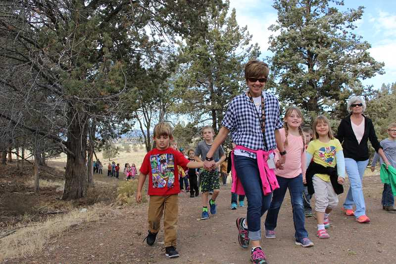 CENTRAL OREGONIAN FILE PHOTO  - Barnes Butte Elementary students and staff explored the IronHorse property late last October with city councilors and employees. The students are working to create a logo and kiosks for the city-owned property.