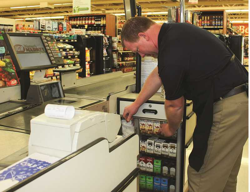 HOLLY SCHOLZ/CENTRAL OREGONIAN  - Wagner's Market Fresh IGA Manager Scott Michel says they don't sell much tobacco at the grocery store. They keep the cigarettes and chew locked up at the check stands.