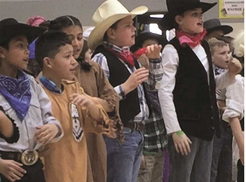 JASON CHANEY - Barnes Butte Elementary School fourth-graders perform a program each year about the Oregon Trail as part of the social studies curriculum.