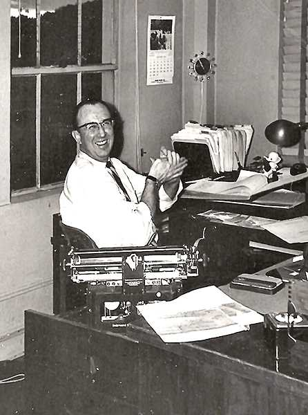 COURTESY OF GENIE ESPENEL AND THE KELLER FAMILY - Chet, working behind the desk as a bookkeeper for the Portco Corporation in Portland for over 35 years. His friends used to say that Chet had a wonderful smile that would light up a room.
