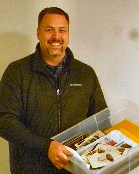 EILEEN G. FITZSIMONS - Dave Elkin, descendant of the Rev. Thomas and Dessie Elkin, shown as he was reclaiming his familys long lost historic photos during the just-past Holiday Season.