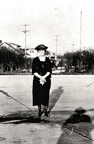 COURTESY SMILE HISTORY COMMITTEE - One of the long-lost photos - Susie Elkin by then Mrs. Errol V. Brown, standing in the old casting pond and wading pool at Sellwood Park. It was replaced by the north parking lot, at the corner of S.E. Sellwood Boulevard and 9th Street. Her husband, Errol, cast a long shadow as he took the photo with his back to the sun.